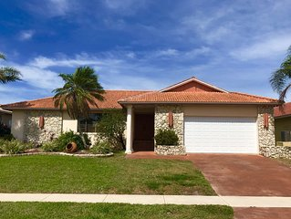 Marco Island lovely house on the water with pool walking distance to beach