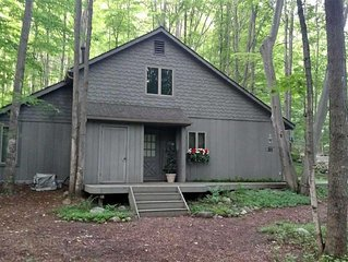 Cottage In Schuss Village on Two Acres In A Wooded Setting