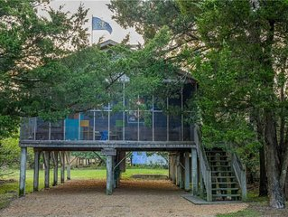 Lindley:  Near restaurants, spacious screened porch, rooftop deck.