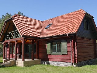 Wooden Cottage in Czarny Mlyn with garden and barbecue
