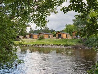 A riverside lodges with spa pool  (dog friendly) that sleeps 4 guests  in 1 bedr
