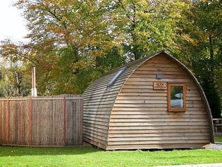 A premium wigwam with hot tub  that sleeps 4 guests, 2 adults are included.