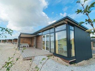 Nice lodge with combi-microwave, near the beach