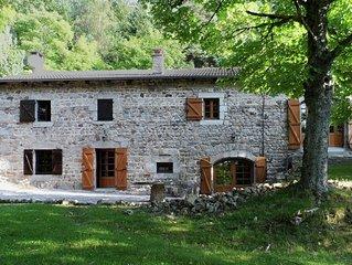 Beautiful stone farmhouse in mountain forest setting
