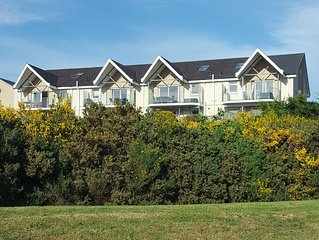 Apartment with balcony overlooking golf course, Moray Firth, mountains and hills