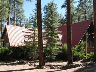 A Red Roof Retreat Nestled In The Pines