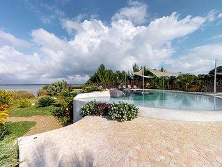 Romantic beachfront retreat w/ a shared pool & ocean views!