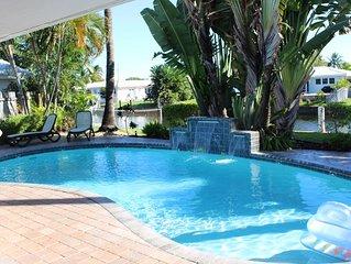 Backyard Paradise: 2bd/2bath Waterfront Home, Heated Salt Water Pool, Tiki Bar