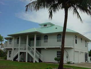 Waterfront vacation home with two master suites, private pool and boat docks.