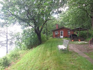 Romantic getaway or family vacation on 10 acres with beach!