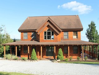 Amazing log home with views that abound! Al Meucci Real Estate