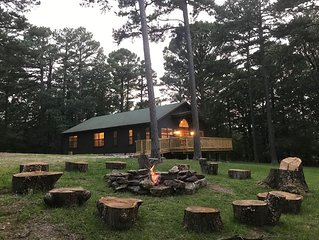 4 br 2 bath cabin 4.5 wooded acres in town. Private retreat Huge yard WiFi