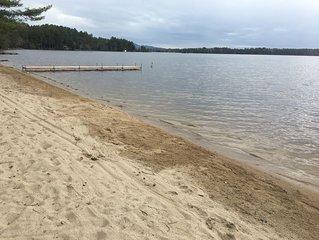 Waterfront Lake Winnipesaukee cottages on private sandy beach sleeps 12 W/dock