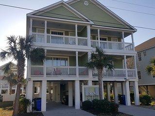 Beautiful Surfside Beach house, steps to the beach.  Pool, golf cart , linens .