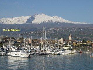Rilassanti vacanze con splendida vista dell'Etna in cui potrai sciando tuffarti