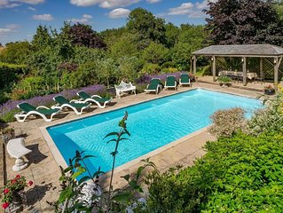 Luxury accommodation with pool and tennis court in stunning setting.
