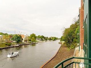 Enjoy the Manistee River Channel in this well-appointed Downtown Condo!