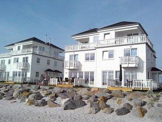 Luxus am Strand:Ferienhaus mit Sauna, Whirlpool, Strandkorb und Meerblick