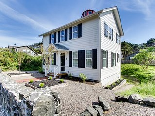 Stunning lighthouse replica home with ocean views, steps from the beach!