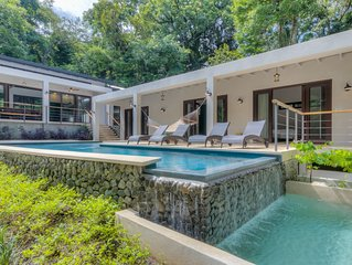 Designed for relaxation, modern family home w/pool & lush yard steps to beach