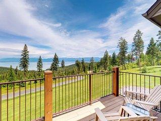 Extravagant home w/ deck, lake views, fitness room & pool table