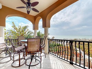 Oceanfront condo features easy beach access, a shared pool, and great views!