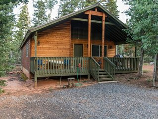 Come enjoy this cozy cabin on a 1/2 acre! Tell stories around the fire pit at ni