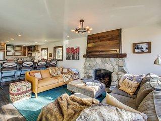 Stunning home w/ deck, lake view, hot tub - near skiing - short stroll to beach!