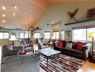 Wooded lodge w/ wrap-around deck - 1 block to the river, close to town/the lake!