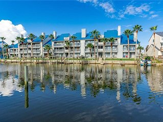 Canal view condo with a boat slip and a shared pool, WiFi too!