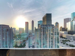 Luxury apartment in high-rise w/ shared pool, fitness room, and downtown views!