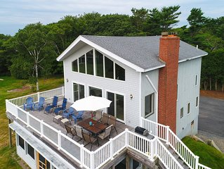 Admire ocean views from the deck of this gorgeous, family-friendly getaway