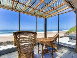 Modern oceanfront house w/ private hot tub & ocean views - walk to beach!