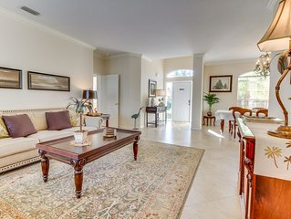 Screened-in pool, lush lakefront views, minutes to beaches!