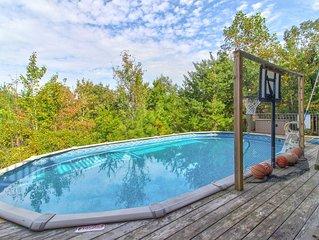 Dog-friendly home w/ majestic views, seasonal pool, hot tub, deck & game room!