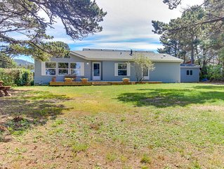 Watch for whales at this oceanfront home with deck, yard, and lighthouse view