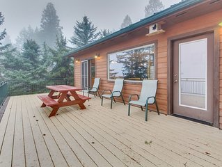 Lakefront getaway with dock, 400 square-foot deck, close to town.