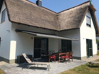 Neues Ferienhaus mit Reetdach, ca. 100 m², sehr hochwertige Ausstattung, Sauna