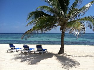 WOW!! BREATHTAKING BEACHFRONT END UNIT JUST STEPS FROM THE TURQUOISE CARIBBEAN!!