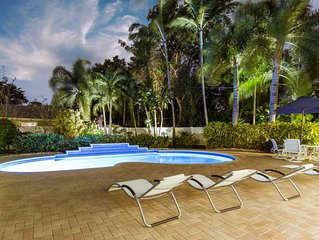 Private Tropical Oasis, Pool! Walk to shopping & entertainment. Great Location.