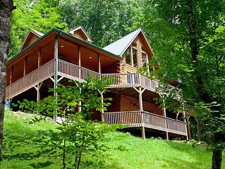 Private log cabin has  4 master suites, views, and an amazing rec room
