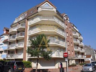 Appartement F2-cabine proche mer et commerces avec terrasse et parking