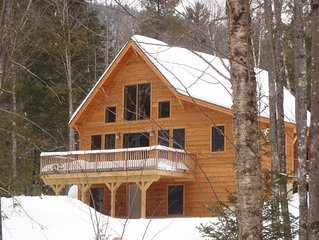 Elegant custom chalet in private wooded location close to skiing, golf, village