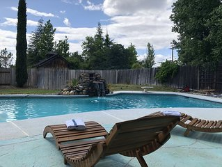 Cozy mid century house with pool, hot tub, Dish Tv, WiFi, fireplace, waterfall