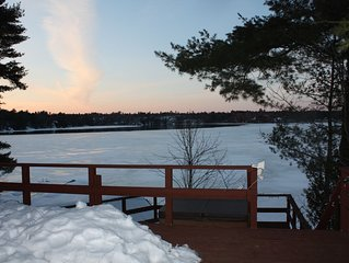 Renovated Lake front cottage with outdoor hot tub and open wood fire place