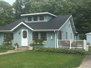 Great Spring lake cottage with private dock and waterfront lot!