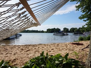 Lake house with private sandy beach on Hutchins Lake!