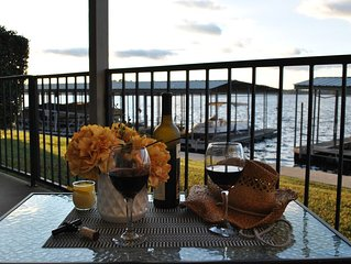 Lake Front Condo 15 feet from the shore line with Large Outside Patio!