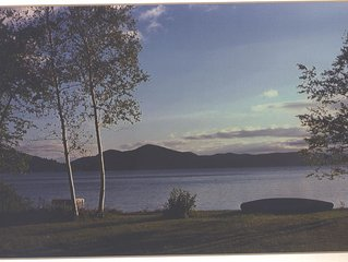 Rustic cottage with beautiful sandy beach right on Lake George