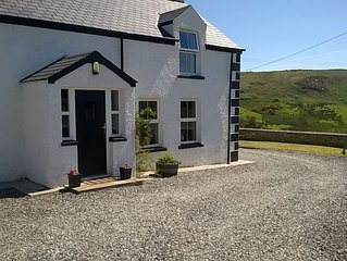 Cosy restored large house - close to Malin Head, beaches and golf courses